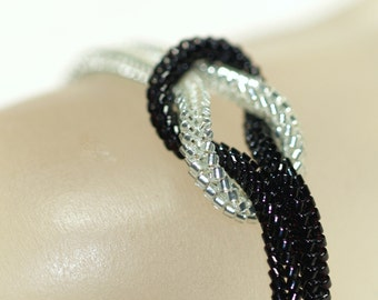 Elegance ... Bracelet . Knotted . Shiny . Jet Black . Silver Lined Crystal . Modern . Sparkle . Knot Ready for Prime Time . Magnetic Closure
