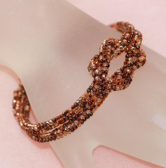 Copper ... Bracelet . Stylish . Simple . Knotted . Knot Ready for Prime Time . Metallic . Peach . Matte . Color Blend