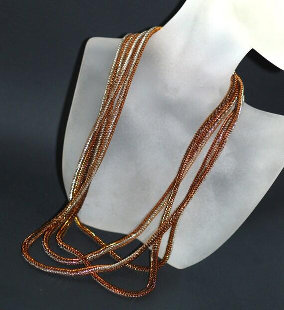 Serpentine Shimmer ... Necklace . Bracelet . Rope . Wrap . Silver . Copper . Topaz . Bronze . Metallic . Ndebele Rope . Versatile . Glitzy