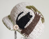 Wool brim hat with a cat / A cat loves a tree