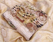 Lacy fabric-collaged journal