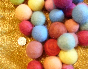 Itty bitty Jingle Felt Balls Colors Available are Green, Rust, Purple , Gray, Red. Blue