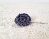 One crocheted circle hair clip in grey