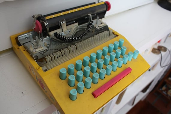 Old Children's Typewriter.  So colorful.