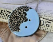 Sheila rose garden in sky blue and black...she is a sew on button...
