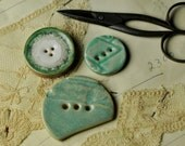 3  buttons in greens & white....sew on buttons