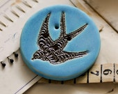 swallow button.... she is a sew on ceramic button