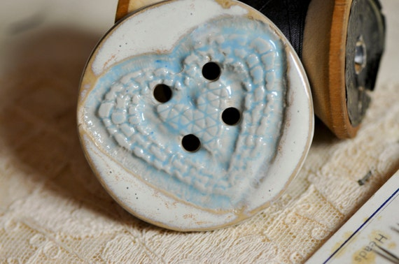 Heart button blue and white.....she is a sew on button