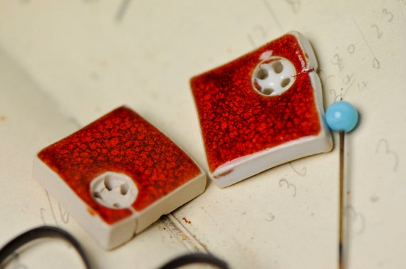 2 red square buttons....sew on buttons