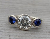 Moissanite, Chatham Blue Sapphire, and Recycled 14k White Gold Three-Stone Wedding or Engagement Ring - Eco-Friendly Diamond Alternative