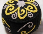 Large swirl flower pincushion black and yellow