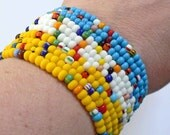 Set of 10 CoLoRFuL RAINBOW seed bead bracelets on a yellow turquoise or white background Child thru Adult Sizes Available