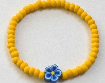 Little Girls Bracelet Yellow beads blue flower. Perfect for your Dora fan. Great Stocking Stuffer Toddlers Preschoolers Kids and Children