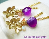 of purple and gold earrings