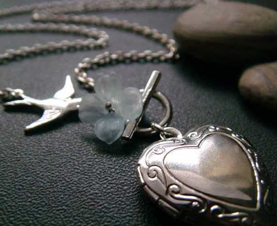 aqualine nectar . floral heart locket necklace .