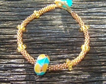 Gold and Teal Seed Bead Bracelet with Blown Glass Bead