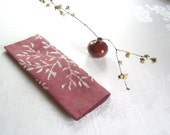 claret red linen towel. bamboo batik print