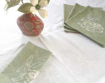 four rabbit napkins. pale sage green batik