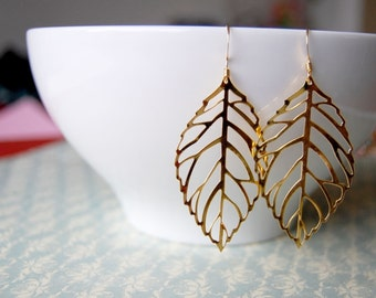 gold leaf filigree dangle earrings - shiny leaves.