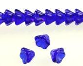 25 pc. 8x6mm Pressed Czech Glass Bell Flower Beads - Transparent Cobalt Blue