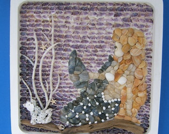 Mermaid Decor, Seashell Mosaic of a Mermaid sitting on the bottom of the ocean with driftwood and coral set in a 9 x 9 white wooden frame