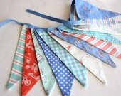 aqua, orange and blue bunting or banner