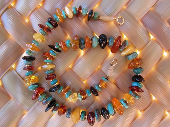 Amber Baby teething necklace with turquoise stones and multicolored amber