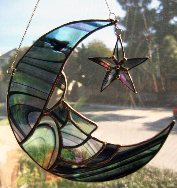 stained glass man in moon  u0026 star suncatcher is in irridized