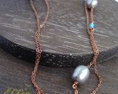 Long necklace with pearls on copper