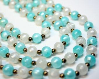 Oceans 4 - Vintage Quad Strand Acrylic Beaded Necklace - 1950s era