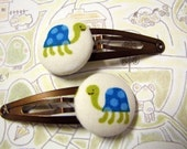 these cutie tortoises are going to the library - 2 hair clips