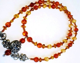Baltic Amber Necklace witn Bali Sterling silver Charm Antique Clasp