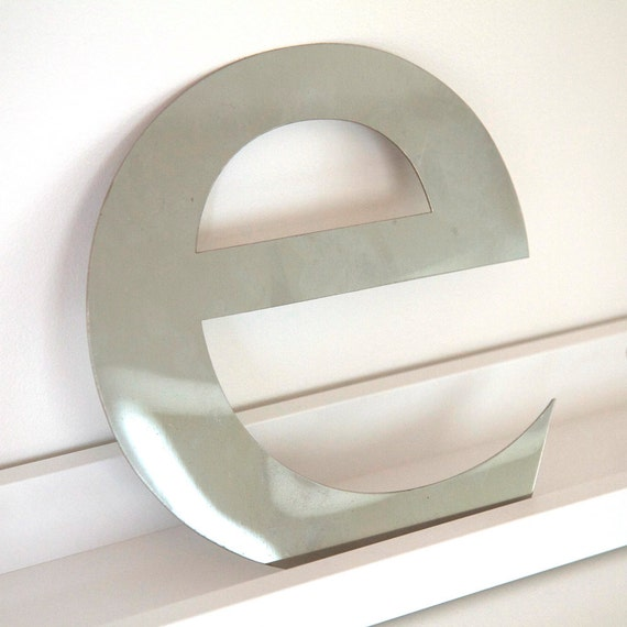 Vintage type  'e'  made from polished metal. includes wall mounts