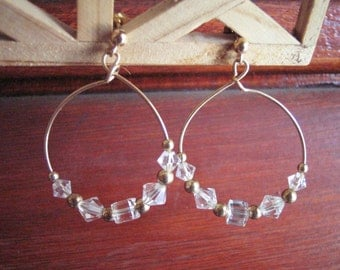 gold-filled hoops with crystals