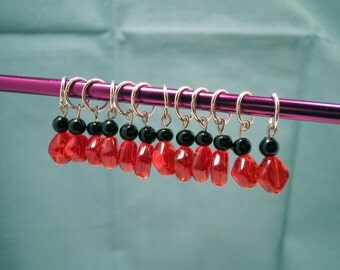 Red and black stitch markers