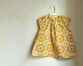 Baby smock 1-2 yrs - mustard wallpaper flowers