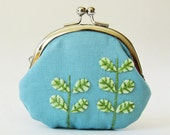coin purse green leaves on sky blue