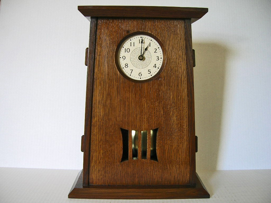 arts and crafts mantel clock with pendulum tapered design