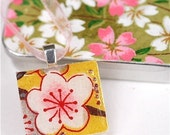 Sakura Pink. Plum Blossom on Yellow, a pendant.