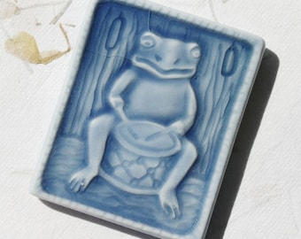 Musical Drumming Frog - Small ceramic tile magent for your home in azure blue
