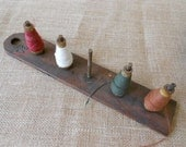 wooden spool holder with four yarn spools