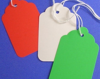 holiday assortment / 30 paper tags with string . red green white