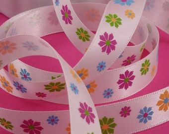 flowers on white . silky poly ribbon .  5/8 inch x 5 yards . LAST in stock