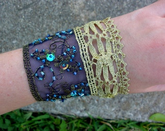 Embroidered blue and gold cuff