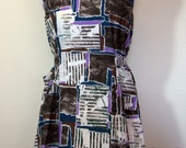 Funky button back apron