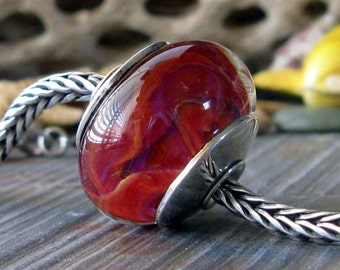 Sterling silver core artisan boro glass lampwork large focal bead. AGB Cranberry Air. Handmade bead caps. Red, pink, hints of indigo. Warm.