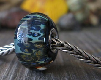 Artisan handmade bracelet charm. AGB sterling silver lined boro glass lampwork bead. Dark mysterious colors. With Your