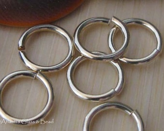 Quality thick 14k gold filled round jump rings. Hand cut artisan handmade jewelry findings. AGB 16 gauge 7mm 25 pieces. Made to order.