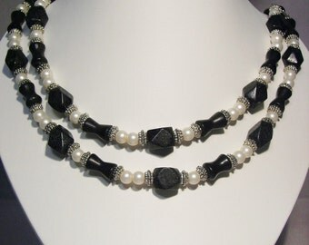 Blackstone, Silver and Pearl Double Strand Necklace and Earring Set was 55.95