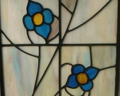 Two Blue flowers in Glass